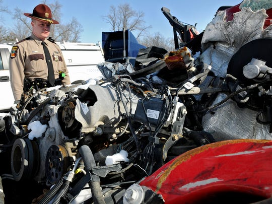 Minnesota State Patrol Sgt. Casey Meagher looks at