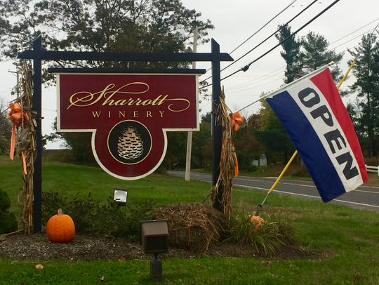 A flag greets visitors headed to Sharrott Winery.