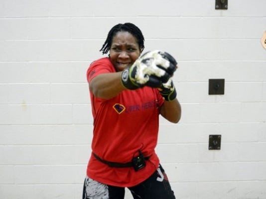 LaKeya Benton's BODYCOMBAT class at the YMCA in Dover Township has become one of the most popular at the branch. (Daily Record/Sunday News -- KATE PENN)
