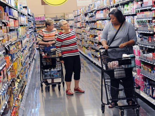 Pat Leyda-Bishop (from left), Carol Fishman and Tabatha Montgomery shop at Metro Market in Shorewood Thursday, Sept. 15.