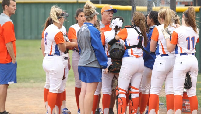 San Angelo Central High School head softball coach David Millsap (center) talks to the Lady Cats before the District 8-6A finale against Killeen Shoemaker at the Central Softball Complex on Friday, April 20, 2018.