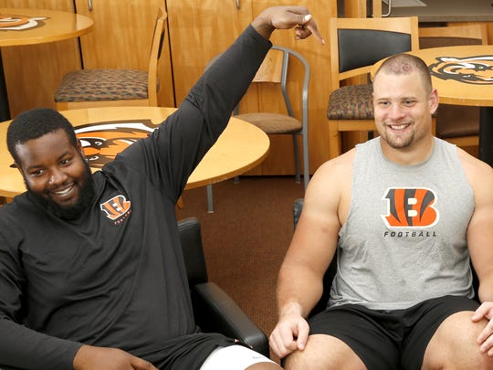 From left: Cincinnati Bengals tackle Andre Smith (71) and guard Kevin Zeitler (68), sit down with Bengals columnist Paul Dehner Jr. for an interview about all things non-football, Thursday, Sept. 24, 2015, at Paul Brown Stadium in Cincinnati, Ohio.