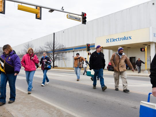 Employees walk to the parking lot after a shift change Tuesday, Jan. 30, at Electrolux in St. Cloud. Electrolux officials announced that the St. Cloud facility, which manufactures Frigidaire upright freezers, will continue production through 2019.