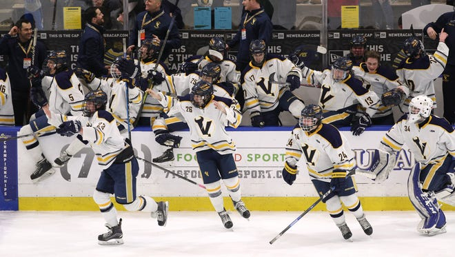 Victor celebrates is 5-1 over Niagara-Wheatfield to win the Division 1 star hockey title on March 11, 2018.