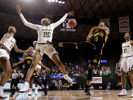 Baylor guard Juicy Landrum (20) blocks a shot by Grambling State's Shakyla Hill (5) as Baylor's Didi Richards, left, and Alexis Morris (11) watch in the first half of a first-round game at the NCAA women's college basketball tournament in Waco, Texas, Friday, March 16, 2018. (AP Photo/Tony Gutierrez)