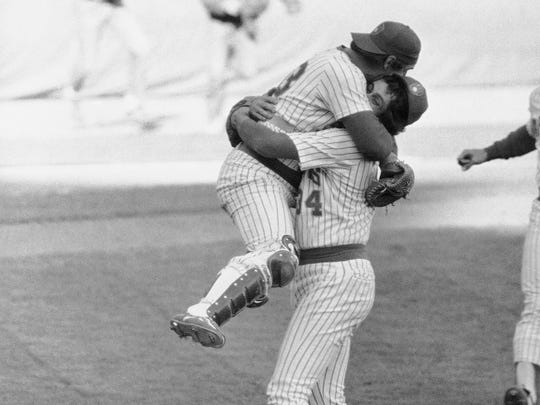 Brewers reliever Rollie Fingers carries catcher Ted Simmons following Milwaukee's 2-1 victory over Detroit to take the American League East second-half championship on Oct. 3, 1981, at Milwaukee's County Stadium.
