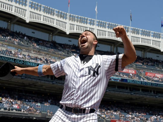 New York Yankees' Nick Swisher reacts when he is introduced at the Yankees Old Timer's Day baseball game Sunday, June 17, 2018, at Yankee Stadium in New York.