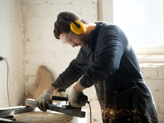 Getty_636626788697710658-man-with-tool.jpg