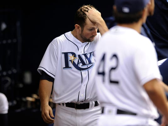 Tampa Bay Rays' Steven Souza Jr. walks in the dugout after visiting a fan in the stands after she was hit by his foul ball during the seventh inning of a baseball game against the Chicago White Sox, Friday, April 15, 2016, in St. Petersburg, Fla. (AP Photo/Steve Nesius)