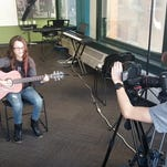From left: Sophia Avecedo of Sophia Avocado Music, Riley Kirkpatrick (aka Kcold Pizza), funky folky rock musician Sydney Burnham and Robert Rodriguez jam together during a video shoot at the Detroit Institute of Music Education to promote The Warehouse Rocks in Livingston County.