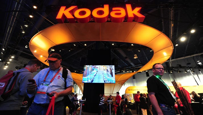 People visit the Kodak display at the International
