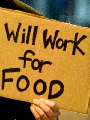Jobless man holding a placard