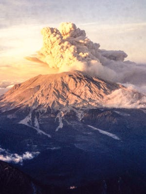 Mushroom-shaped clouds of ash from subsequent eruptions of Mount St. Helens are captured in photographs taken at sunset from the cockpit of a Cessna 150 in 1980. The photos, which were recently found, had been presumed lost.