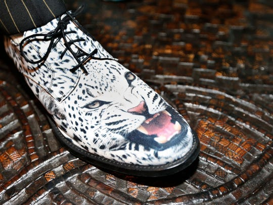 Michael Willhoit wore shoes with a white leopard on them during his house opening, a fundraiser for Friends of the Zoo in July 2015.