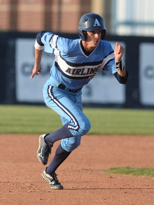 Cameron Parikh sprints to third base during his game against Central Lafourche.