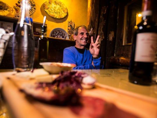 John Rao, co-owner of Pizzeria Verita, jokes about