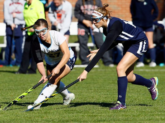 West Morris'  Kate Hennelly vs. Chatham's Charo Fernandez in the NJSIAA North 1 Group III field hockey semifinal. West Morris won 2-1 in overtime. October 31, 2017. Chester, New Jersey