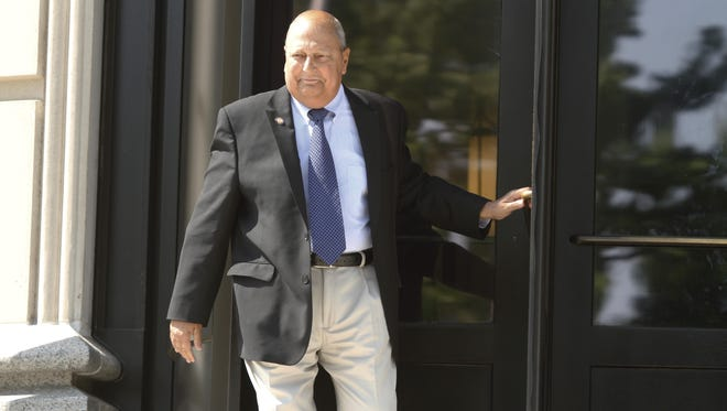 New York Sen. Thomas Libous leaves the White Plains Federal Courthouse in White Plains.