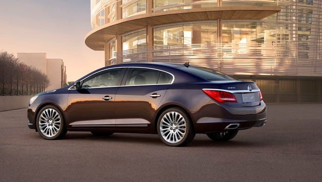 The 2014 Buick LaCrosse is animated by a 3.6-liter V6. It's pictured with a metallic Midnight Amethyst exterior color and 20-inch premium painted alloy wheels.