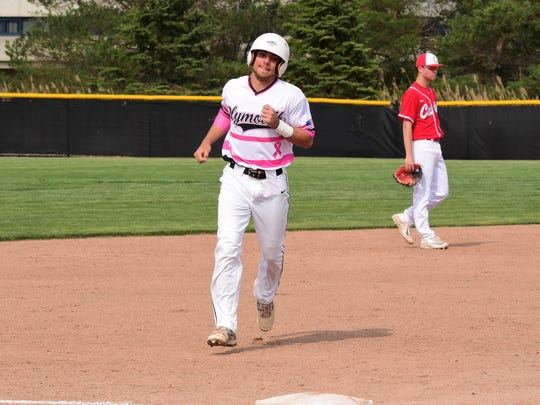 Rounding the bases after crushing a two-run homer in Wednesday's opener is Plymouth's Kyle Aniol (9). The home run put the Wildcats up 2-1.