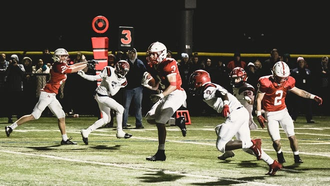 Melrose's Chris Cusolito sees nothing but daylight ahead to score one of his 25 touchdowns last year during a playoff game versus Revere.