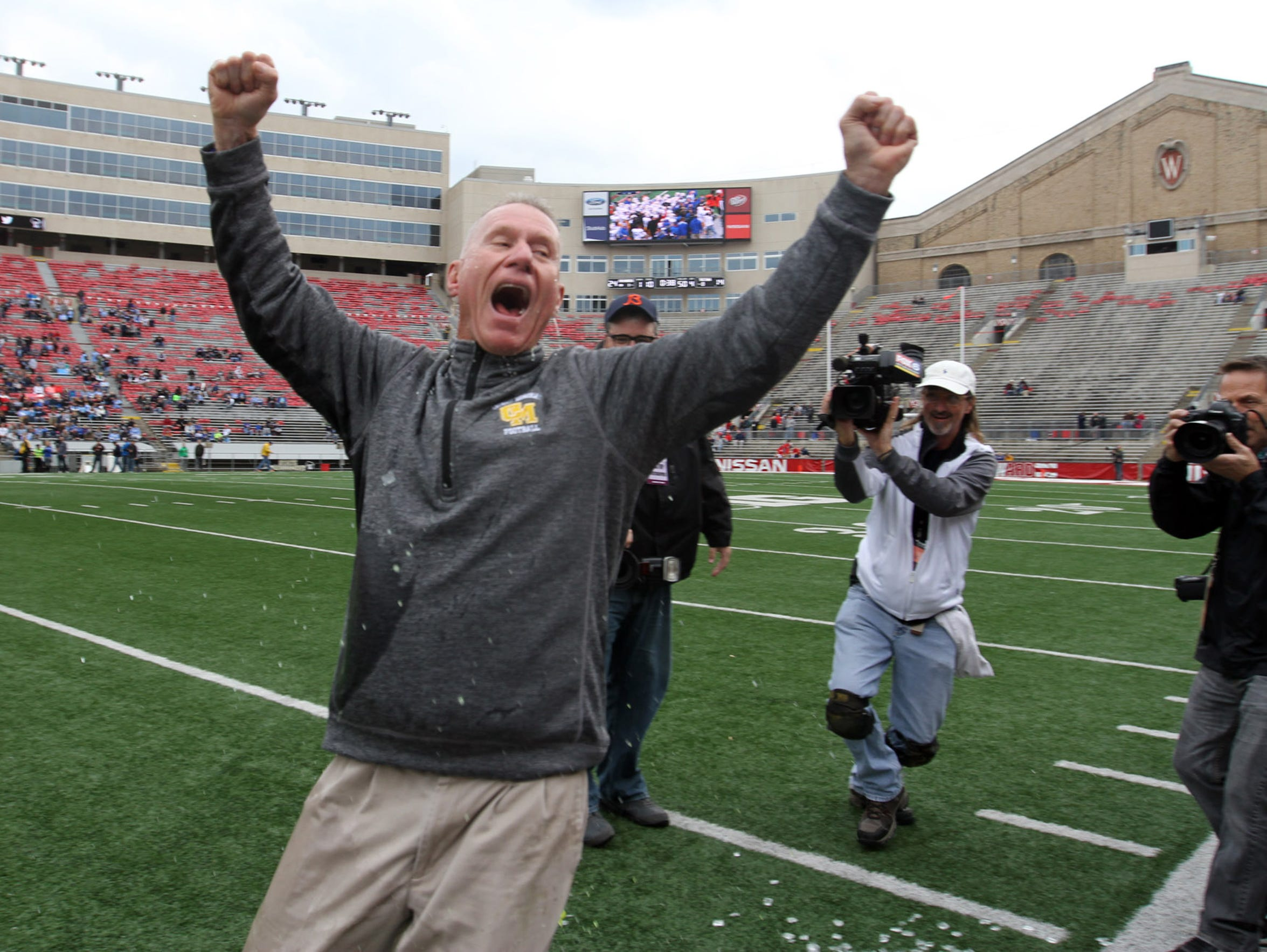 Catholic Memorial head coach Bill Young celebrates