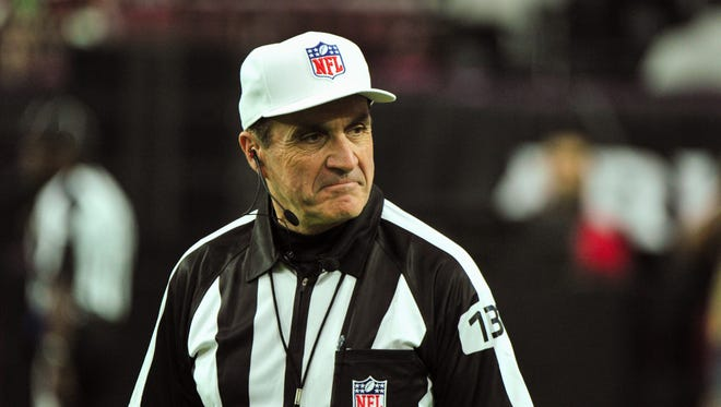 NFL referee Pete Morelli looks on prior to the game between the Arizona Cardinals and the Kansas City Chiefs in a preseason NFL football game at University of Phoenix Stadium.