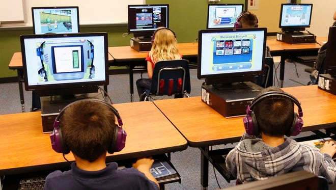 In this July 21, 2014 file photo, students at a summer reading academy at Buchanan Elementary School work in the computer lab at the school in Oklahoma City. Wading into one of the most polarizing issues in education, President Barack Obama called Saturday for capping standardized testing at 2 percent of classroom time, while conceding the government shares responsibility for having turned tests into the be-all-and-end-all of American schools.