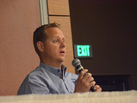 Dr. Mark Himes discusses concussion-related symptoms during Friday's concussion symposium at Farmington Civic Center.