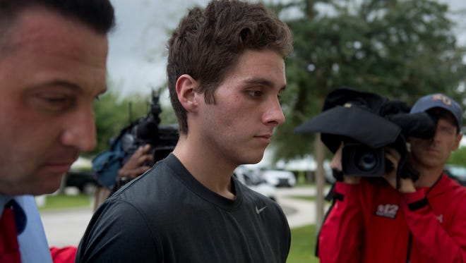 Images from Austin Harrouff arriving at the Martin County Sheriff's Office to be processed into the Martin County Jail on Monday, Oct. 3, 2016, in Stuart. Harrouff was charged with two counts of second-degree murder, attempted murder, resisting an officer without violence and burglary of a dwelling while armed, according to Sheriff William Snyder, in the deaths of a Martin County couple. Harrouff was released from a Palm Beach County hospital Monday before being booked at the Martin County Jail.