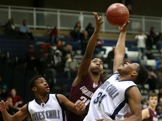 Aquinas' Sam Kelly (21) and Gates Chili's Vincent Ibezim (34) fight for a rebound.