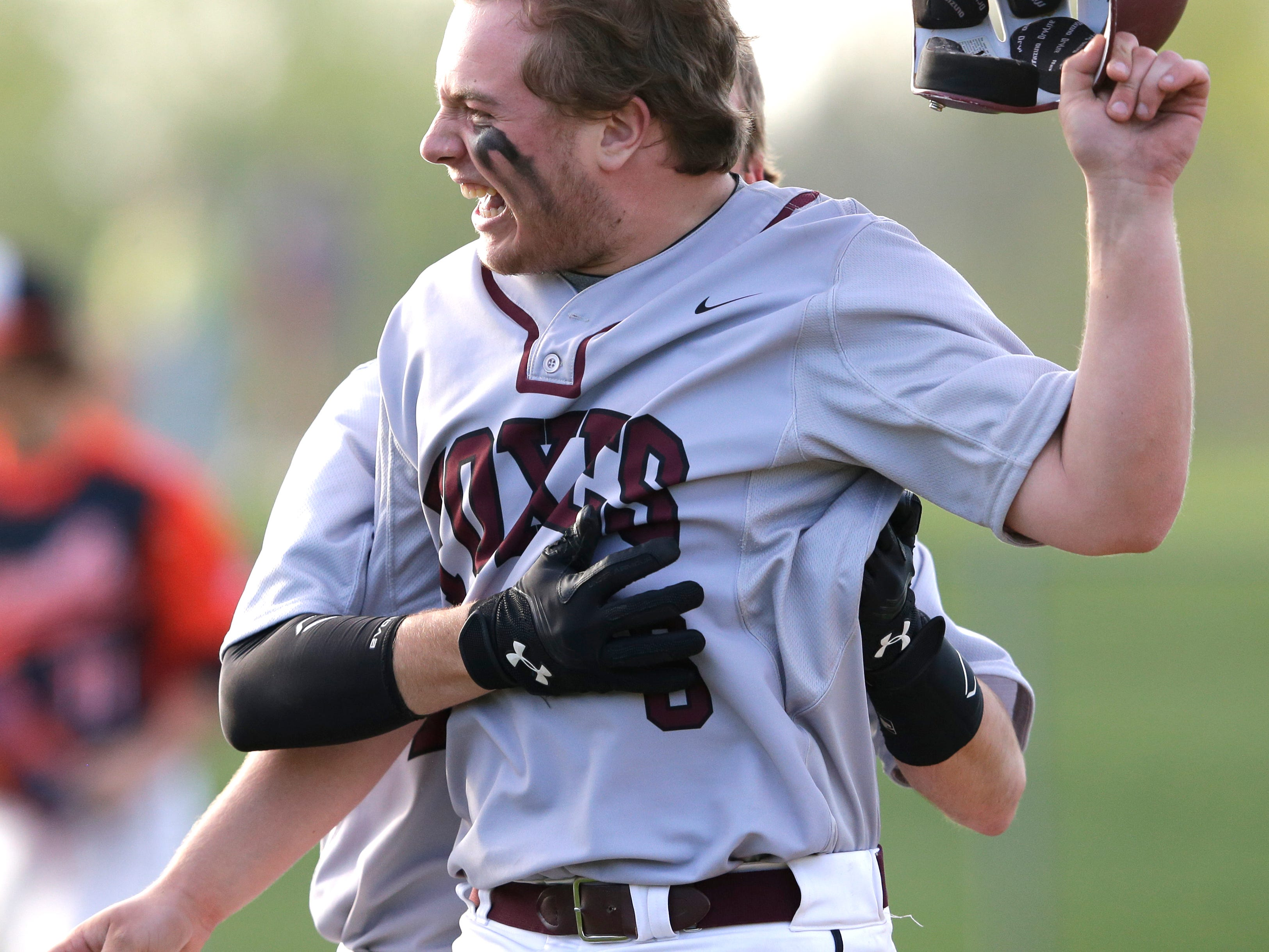 Fox Valley Lutheran's Jake O'Kane celebrates after driving in the game-winning run against Clintonville on Thursday.