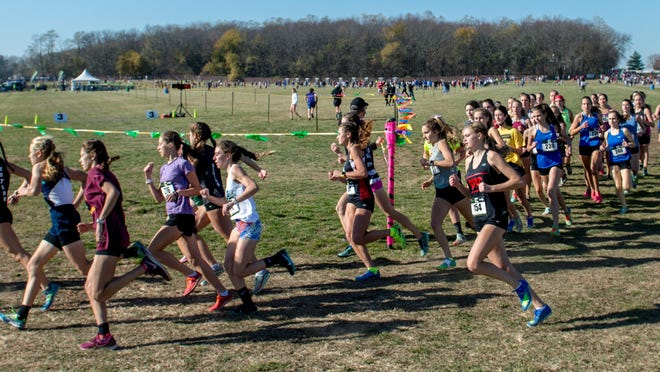 Runners round the first turn after the start of the top flight of the Girls Division II race of the Shazam Racing 2020 XC Championships on Saturday, Nov. 7, 2020 at Three Sisters Park in Chillicothe.