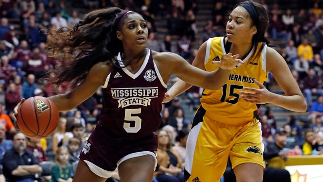 Mississippi State forward Anriel Howard (5) dribbles up court past Southern Mississippi center Amber Landing (15) during the first half of an NCAA college basketball game in Hattiesburg, Miss., Friday, Dec. 14, 2018. (AP Photo/Rogelio V. Solis)