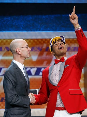 D'Angelo Russell, right, gestures upward as he is greeted by NBA Commissioner Adam Silver after the Los Angeles Lakers selected Russell with the second pick in the NBA basketball draft, Thursday, June 25, 2015, in New York.