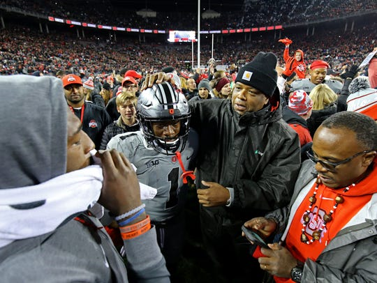 Fans rush the field and celebrate with Ohio State receiver