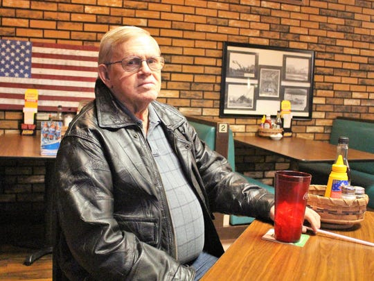 Curtis Prise sits inside the restaurant that he has