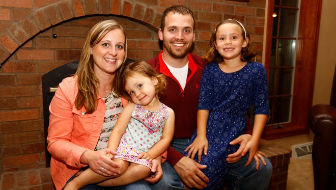 Jared Seubert, his wife Bethany, 6-year-old daughter Tyla, and 2-year-old daughter Kali, pose for a photo Wednesday, Sept. 21, 2016, at Bethany's childhood home in Marathon.