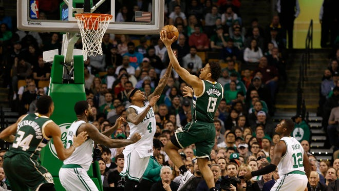 Bucks guard Malcolm Brogdon goes to the basket against Celtics guard Isaiah Thomas during the second half at TD Garden.