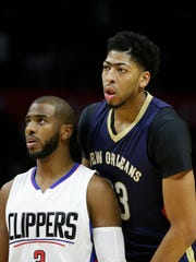 FILE - In this Friday, Nov. 27, 2015 file photo, New Orleans Pelicans' Anthony Davis stands behind Los Angeles Clippers' Chris Paul during the first half of an NBA basketball game in Los Angeles. Anthony Davis can't play. Chris Paul doesn't want to.  Three months before the Olympics, the U.S. men's basketball team has already been losing players. Not just any players, but some of the best in the sport.(AP Photo/Jae C. Hong, File)