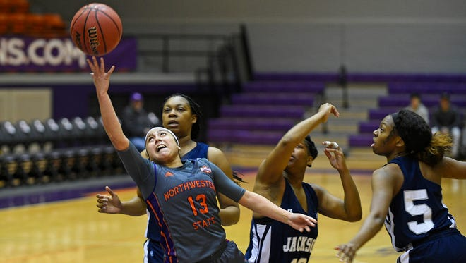 Northwestern State's Janelle Perez tries to grab the basketball during Saturday's game.