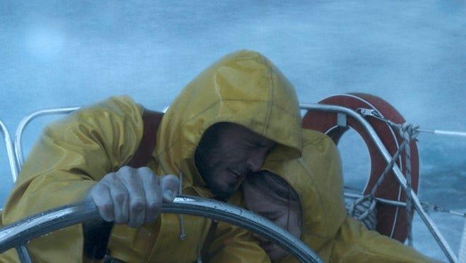 "Richard (Sam Claflin) and Tami (Shailene Woodley) battle a storm in ""Adrift."""