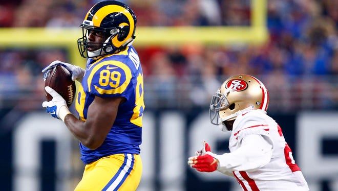 St. Louis Rams tight end Jared Cook, left, catches a 49-yard pass as San Francisco 49ers cornerback Kenneth Acker defends during a November 2015 game in St. Louis.