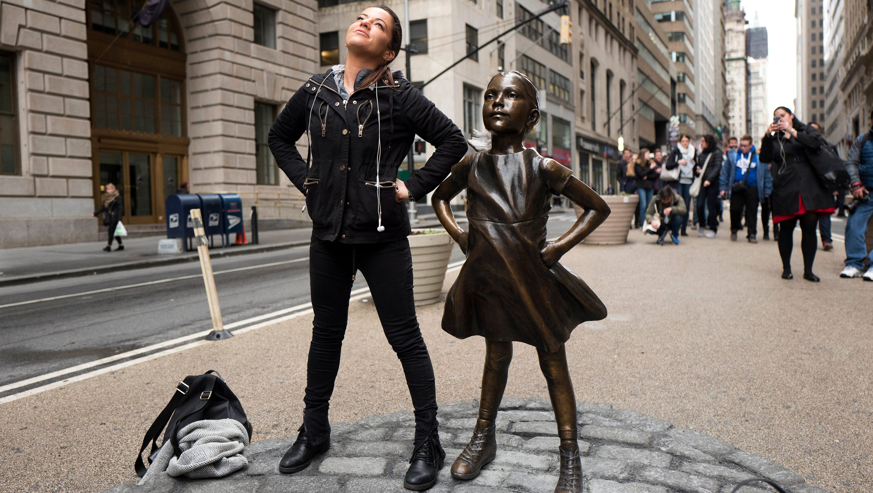 Fearless girl moving to face off instead with new york for Swapping houses instead of selling