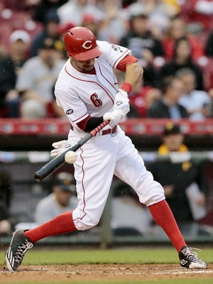 Cincinnati Reds center fielder Billy Hamilton (6) singles on a ground ball to right field in the bottom of the third inning of the MLB National League game between the Cincinnati Reds and the Pittsburgh Pirates at Great American Ball Park in downtown Cincinnati on Monday, May 9, 2016.