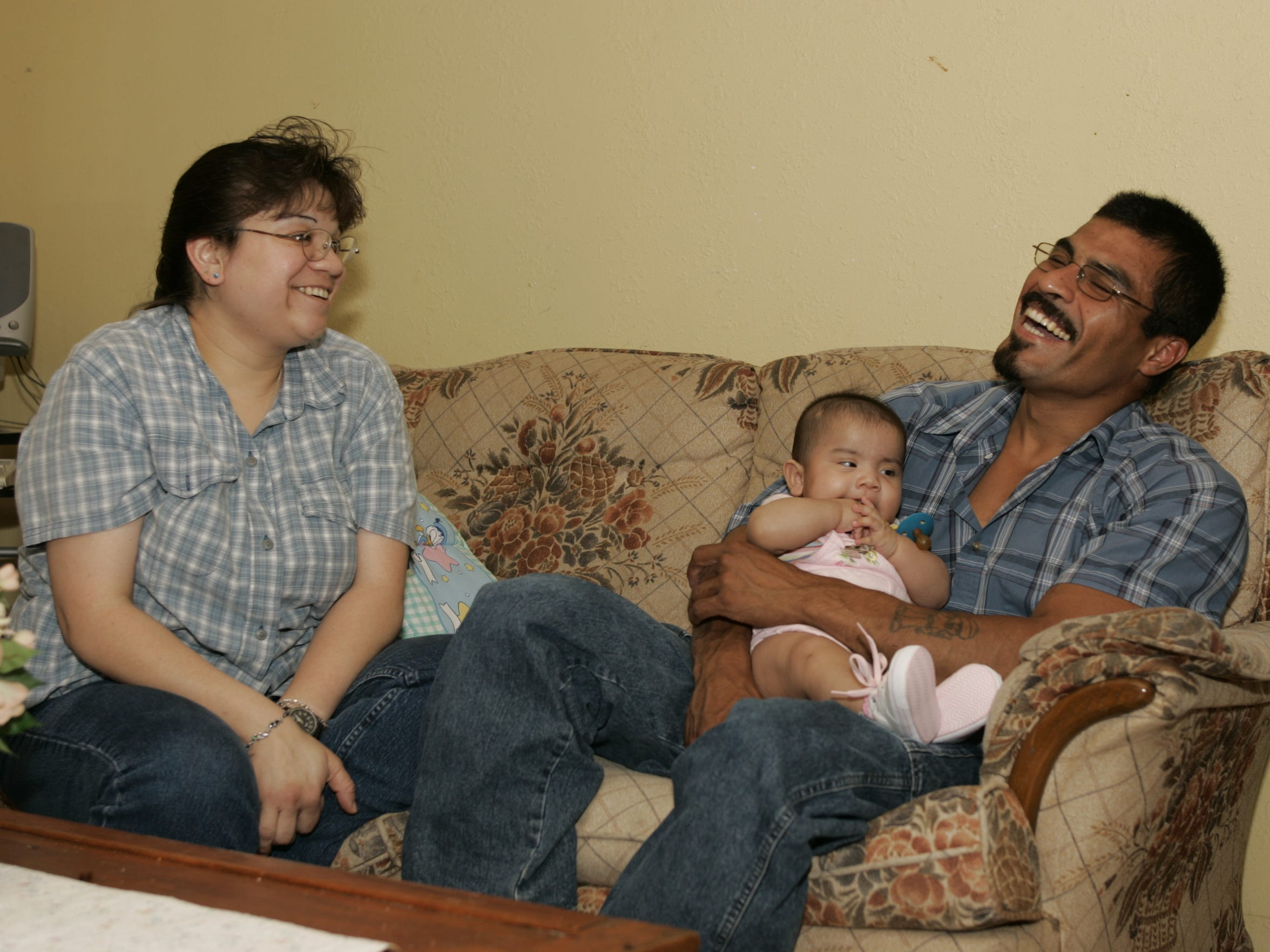 Silvestre Segovia, then 32, with his wife, Ortencia, and their daughter, Destinee, then 5 months old, in their home in Kerrville, Texas, in May 2005.