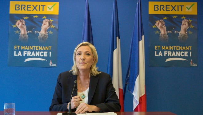 French far-right leader Marine Le Pen speaks during a press conference at the National Front party headquarters in Nanterre, outside Paris, on June 24, 2016. Le Pen says pro-independence movements in the European Parliament will meet soon to plan their next move after the U.K. vote to leave the European Union.