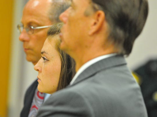 Rebecca Gotay stood stoically between her lawyers as Judge James Earp sentenced her  to seven years in prison and eight years probation late Friday afternoon at the Viera courthouse. He had sentenced Jessica Umberger to the same sentence earlier.