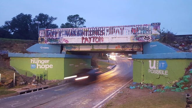 The 17th Avenue Graffiti Bridge is painted to launch MANNA's capital campaign, From Hunger to Hope.