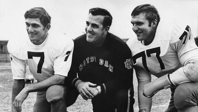 Notre Dame Head Football Coach Ara Parseghian poses with Quarterback Joe Theismann (7) and All-America defense tackle Mike McCoy during picture session on their arrival, Dec. 29, 1969 in Dallas, Texas.